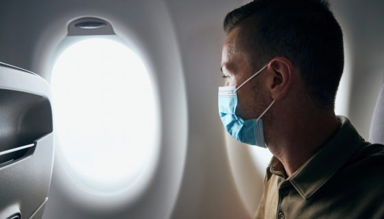 Man,wearing,face,mask,inside,airplane,during,flight.,themes,new